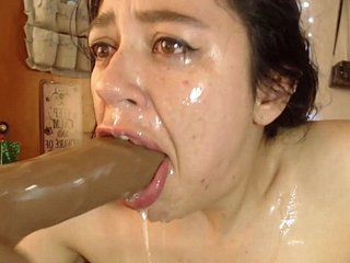 Throatfucking a hulking dildo with an increment of cross-eyed orgasm